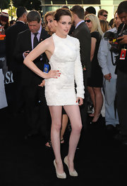 Kristen paired her textured Marchesa mini dress with the suede, spike-heeled Big Lips pumps.