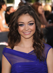 Sarah Hyland went for a simple yet elegant hairdo while walking the red carpet in her vibrant purple dress and matching eyeshadow.