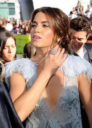 Nikki Reed highlighted her feathered frock with a sparkling cocktail ring.