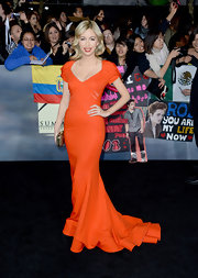 Christian Serratos lit up the 'Breaking Dawn' LA premiere in this saturated orange hue.