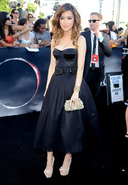 Christian wore a black bustier evening dress with a bow-detailed waistline and a layered tulle skirt.