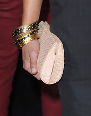 Danica Patrick layered gorgeous gold bangles on her arm at the premiere of 'Breaking Dawn.'