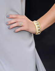 Ashley Greene paired her sleek dress with neutral gray polish.