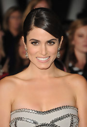 Nikki wore an edgy dress but styled her hair in a romantic 'do for the 'Breaking Dawn' LA premiere.