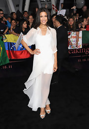 Julia Jones was angelic in a white chiffon dress. She paired her look with silver peep-toe pumps.