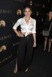 Q'Orianka Kilcher paired her top with black split-leg pants.