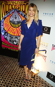 Claire paired her vibrant blue wrap dress with t-strap black heels, which made for a great style combination.