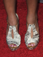 Monique flaunted these satin ankle strap heels on the red carpet. Adding a pair of heels with a print or texture is an easy way to spice up any simple dress.