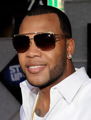 Flo Rida added a pair of shield sunglasses to his summer look.