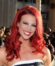 Brenda sported fiery-red curls with matching lipstick and mega-watt lashes.