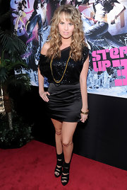 Debby paired her sequined embellished ensemble with a gold-and-black bangle bracelet.