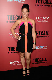 Monique Gabriela Curnen sported a casual but cool black dress with peach and pink trim.