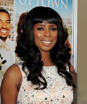 Tasha Smith styled her raven locks in soft big curls at the premiere of 'Jumping The Broom.' She topped off her look with blunt cut bangs.