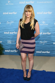 Hilary wore a purple and pink mini to brighten up her look at the 'Soul Surfer' premiere.