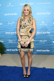 Carrie Underwood added sparkle to her girlish premiere look with a Swarovski sequined envelope clutch.