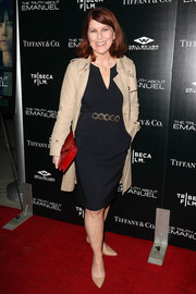 Kate Flannery was classic in a beige trenchcoat layered over a navy sheath at the premiere of 'The Truth About Emanuel.'