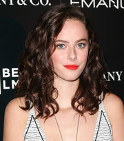 Kaya Scodelario topped off her look with a bright red lip color.