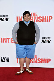 Harvey Guillen kept his red carpet look preppy and cool with a classic sweater vest paired over a button down and bow tie.