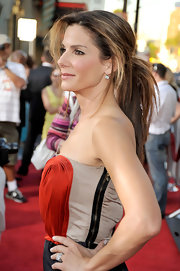 Sandra Bullock topped off her look with a messy ponytail.