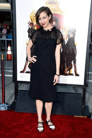 Kristen Schaal opted for flat black-and-white sandals to finish off her red carpet look.