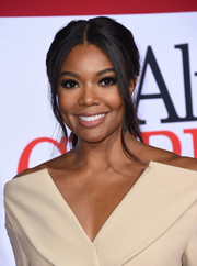 Gabrielle Union looked lovely wearing this loose, center-parted ponytail at the premiere of 'Almost Christmas.'