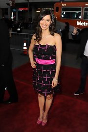 Charlene Amoia attended the 'American Reunion' premiere wearing a shiny black strapless dress with hot pink detailing.