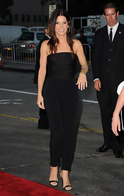 Sandra Bullock opted for a minimalist look at 'The Change-Up' premiere with a pair of black ankle strap sandals. The satin heels dressed up the brunette beauty's strapless jumpsuit.