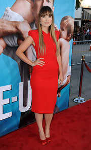 Olivia Wilde donned a red cocktail dress for the premiere of 'The Change-Up.' She paired the look with sleek locks and a diamond Talulah Infinity bangle.
