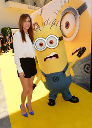Kristen Wiig teamed black shorts with a conservative white blouse for her 'Despicable Me 2' premiere look.