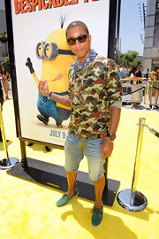 Pharell paired denim cutoff shorts with colorful suede loafers.