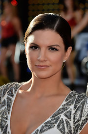 Gina Carano looked sleek and lovely with a classic side-parted bun.
