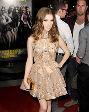 Anna Kendrick accessorized her shimmering shift with an even more eye-catching gold clutch.