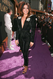 Lorenza Izzo complemented her jumpsuit with black slim-strap heels.