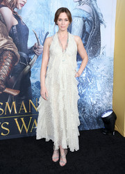 Emily Blunt completed her boho-elegant look with strappy silver heels by Christian Louboutin.