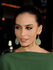 Genesis Rodriguez stepped out at the premiere of 'Identity Theft' with her hair styled in a twisted bun.