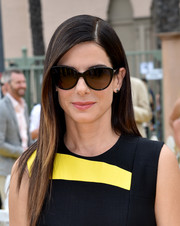 Sandra Bullock styled her look with a classic pair of cateye sunglasses.
