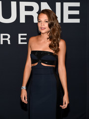 Alicia Vikander paired a Bulgari diamond cuff with a Louis Vuitton cutout dress for total glamour at the 'Jason Bourne' premiere.