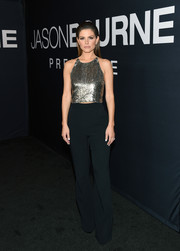 Maria Menounos brought major glitter to the 'Jason Bourne' premiere with this sequined halter top.