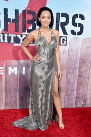Kiersey Clemons matched her gown with strappy silver evening sandals.
