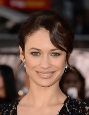 Olga Kurylenko opted for a stylish and chic pinned updo that left only a few face-framing curls hanging down.