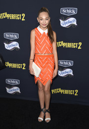 Maddie Ziegler accessorized with a beaded white clutch.