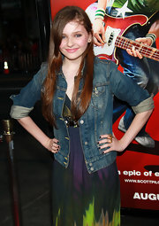 The actress topped off her printed dress with a classic jean jacket.