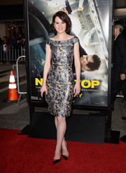 Michelle Dockery completed her outfit with a pair of two-tone PVC pumps by Christian Louboutin.