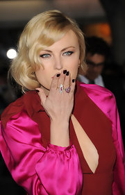 Malin Akerman attended the premiere of 'Wanderlust' wearing a deep burgundy-infused black nail polish.