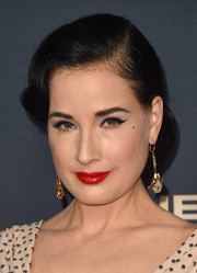 Dita Von Teese polished off her ensemble with a pair of dangling crystal earrings.