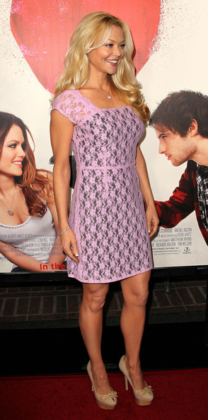 Charlotte Ross gave her pink lace dress a girlie finish with nude canvas platform pumps adorned with petite bows.