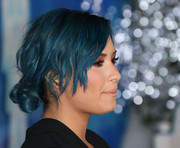 Demi Lovato styled her blue hair in a messy-glam knotted chignon for the premiere of 'Frozen.'