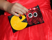 Stefanie Scott wore an adorable Pac-Man inspired sequined clutch to the premiere of 'Wreck-It Ralph.'