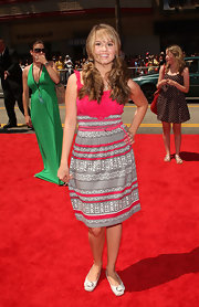 Debby Ryan paired her striped day dress with cream ballet flats at the premiere of 'G-Force'.