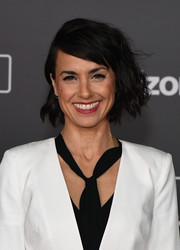 Constance Zimmer attended the premiere of 'Rogue One: A Star Wars Story' wearing her hair in messy waves.